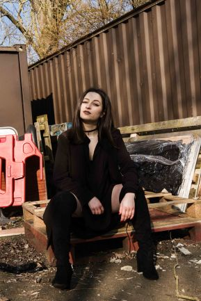 Model Sat on pallets in a rustic urban location