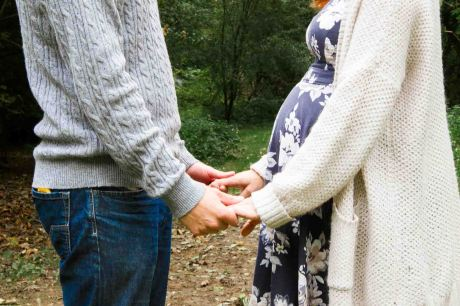couple baby bump session with couple holding hands