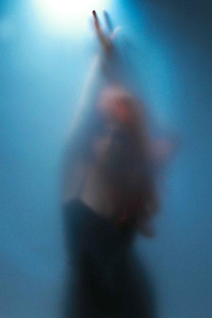 Blue silhouette portrait with faint model features