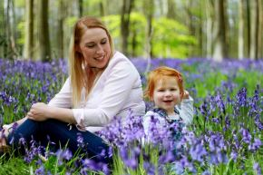 Mother and daughter sitting in the bluebells