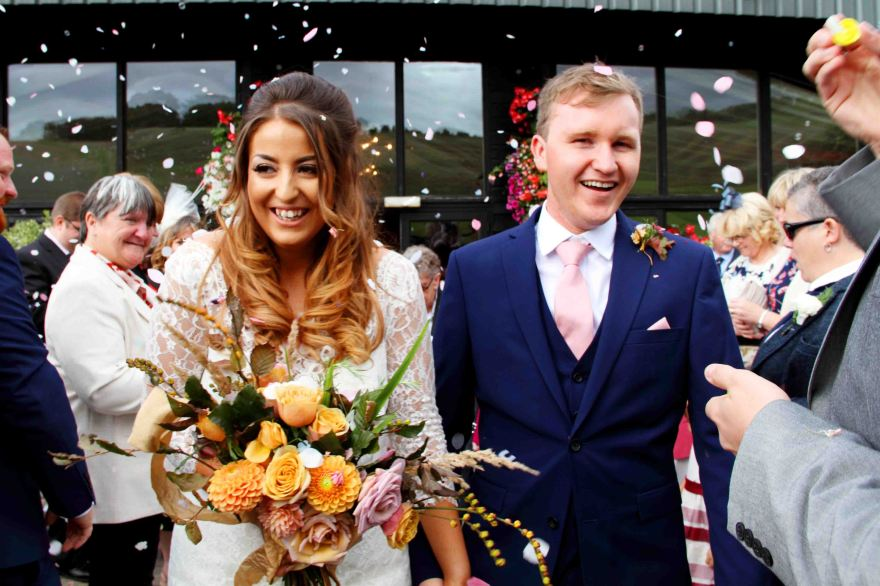 wedding portrait of bride and groom with confetti