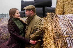 Farmers wife and husband cuddling on the farm