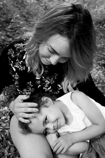 Black and white mother and daughter portrait