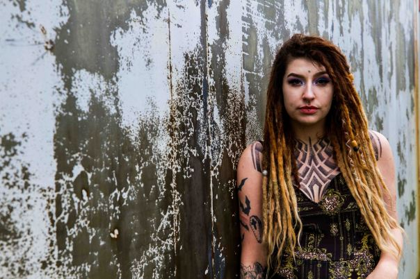 rustic grey urban background and portrait of a model with dreadlocks