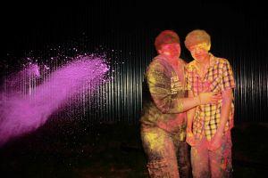 Powder paint being thrown at two men