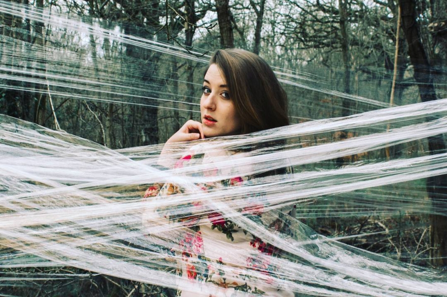 Self portrait of myself hidden behind clingfilm in a forest