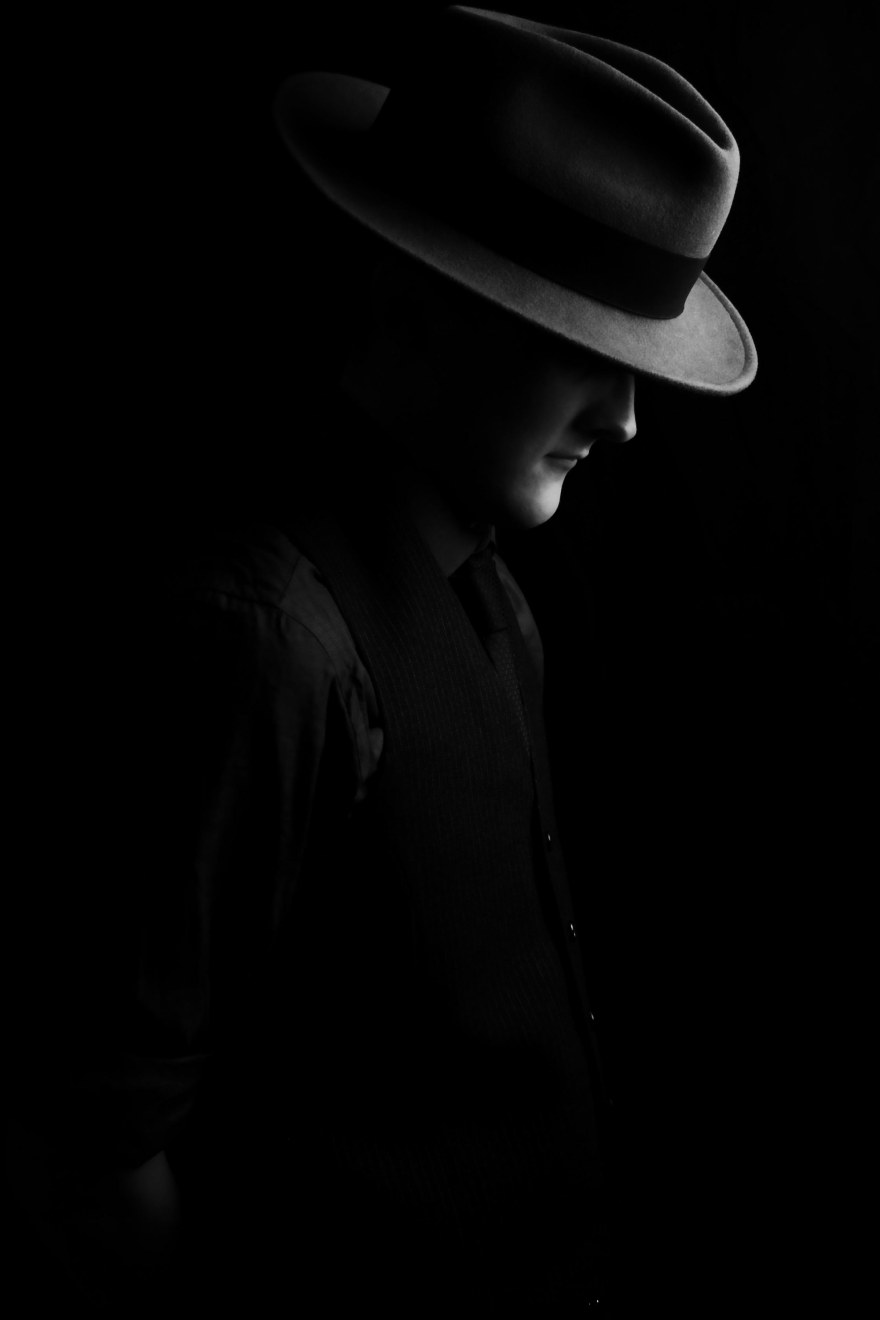 Low key portrait of man with fedora