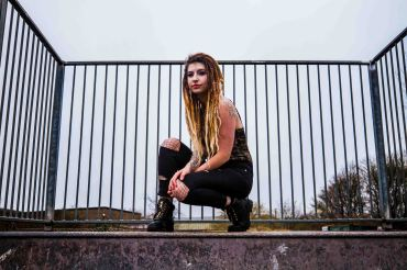 Portrait of model knelt in a skate park