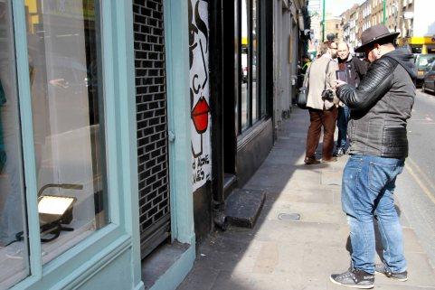 Man taking a photo in a street portrait