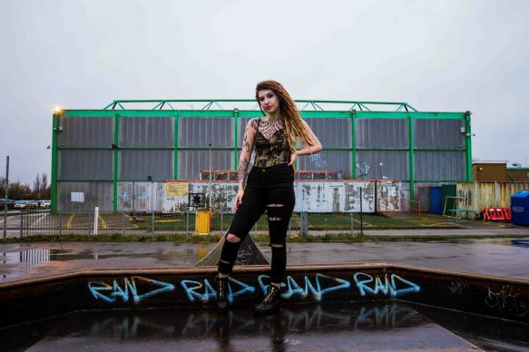 model with dreadlocks portrait in skatepark