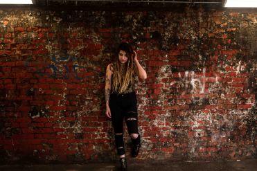 model with dreadlocks portrait with graffiti background