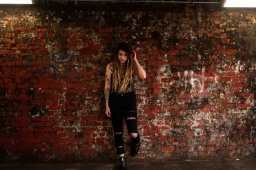 model with dreadlocks portrait with graffiti background
