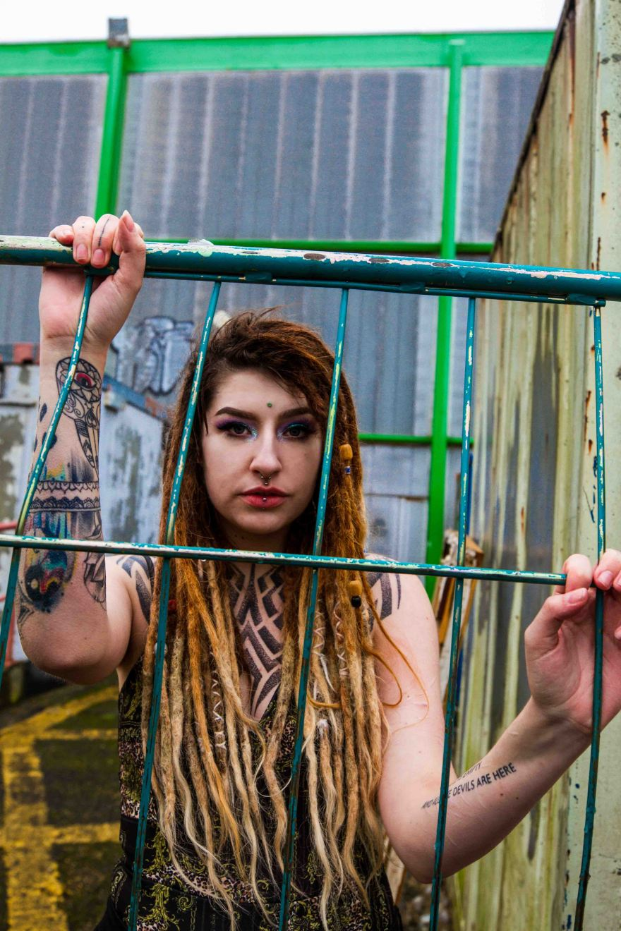 model with dreadlocks portrait with railings