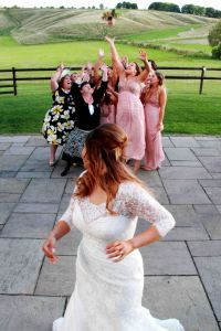Bride throwing her bouquet