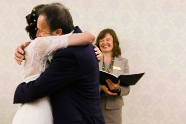 bride and groom hug as they are announced as husband and wife
