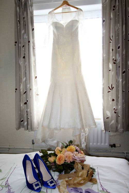 bride's wedding dress with bouquet and flowers