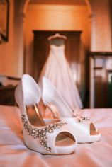 wedding dress photo with shoes in front of it