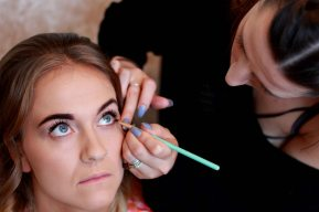 bridesmaid having her make up done