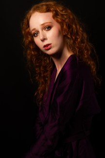 Side profile portrait of Gemma in purple gown