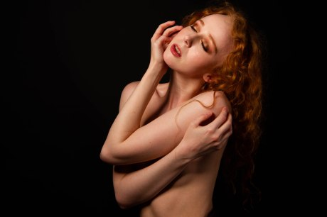 Topless portrait of red haired model gemma holding herself