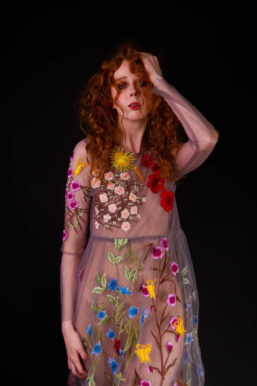 Ginger model portrait in sheer floral dress