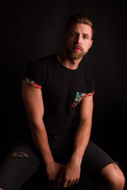 Male model low key portrait in studio